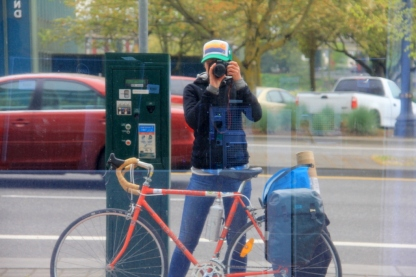Classic Portland cycling photo in one of the many reflective building windows